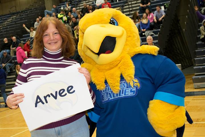 Arvee poses with the mascot contest winner, Cristina Szterensus