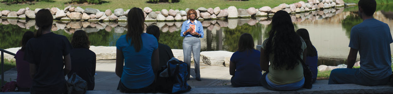 Professor Paulette Gilbert teaches a class outside of the Jacobs Center for Science and Math by the creek.