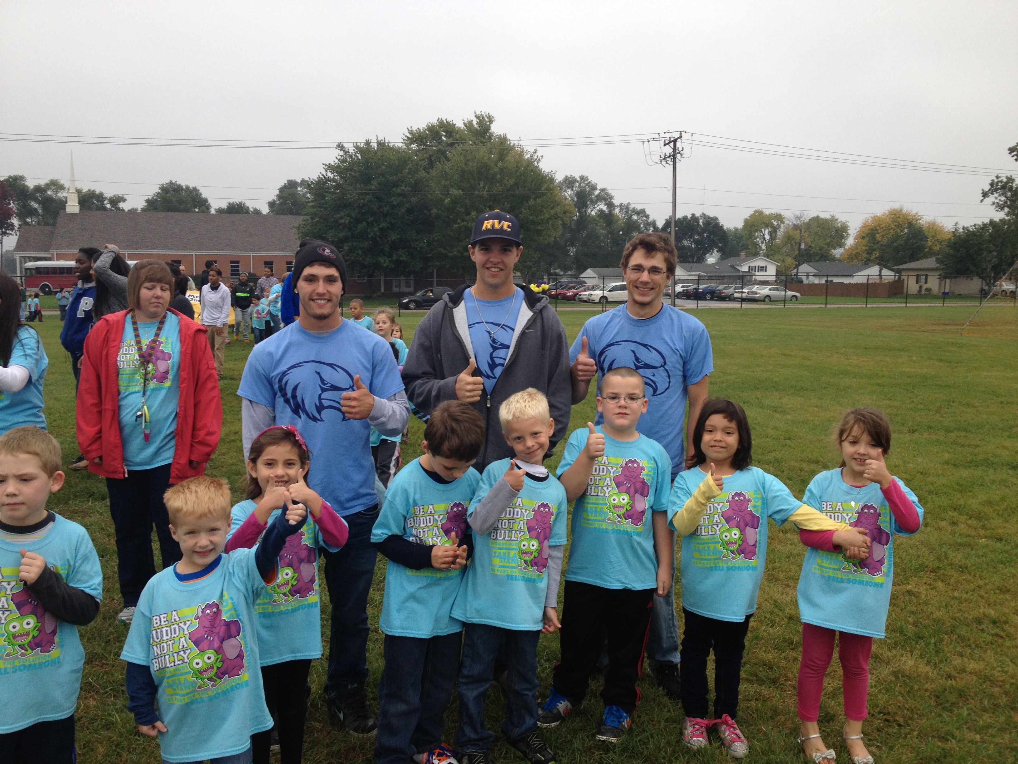 RVC student-athletes (back row, left to right): Sean Wight, Daxx Spera, Casey Williams, along with Windsor Elementary students.