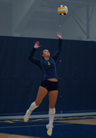 Alexys Cleaver gets ready to serve in volleyball