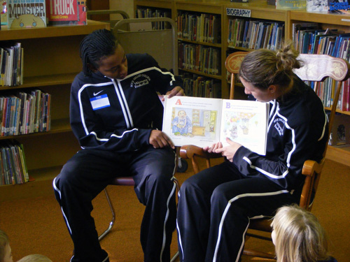 Cierra Morris and Lauren Paulson read to students at Bloom School as part of the Golden Eagle Golden Reader Program.