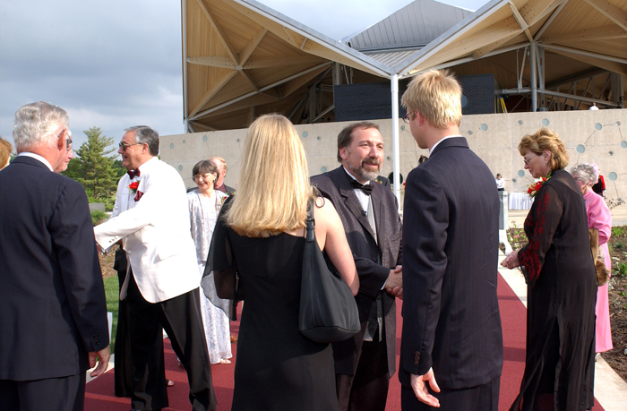 Mike Webb greets guests on the red carpet at the Starlight Theatre roof-opening gala on June 10, 2003.