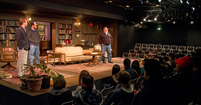 Mike Webb instructs students from the Studio Theatre stage.