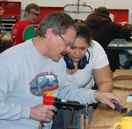 RVC AMT instructor Greg Heckman demonstrates riveting to a second semester student.