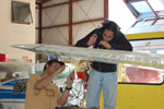 Second year students inspect wing assembly