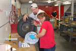 First year students service wheel and tire assembly