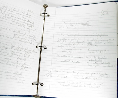 French notes in a notebook.