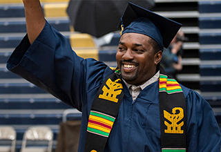 Smiling diverse graduate at graduation