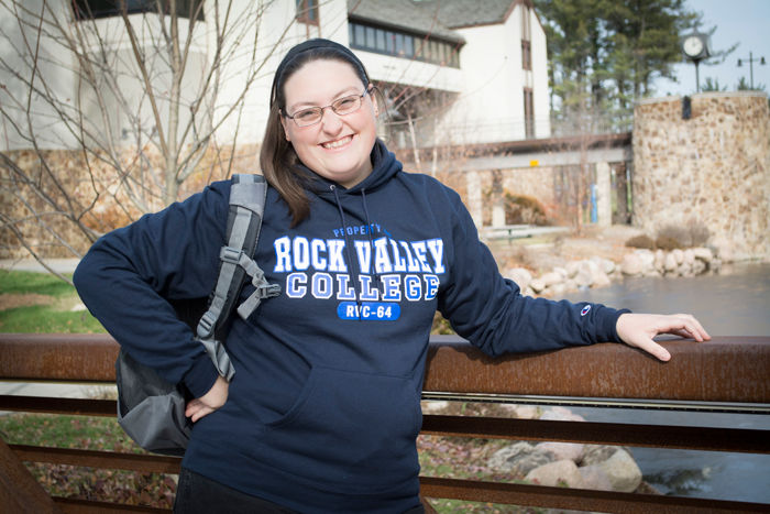 A female RVC student on the bridge in an RVC hoody.