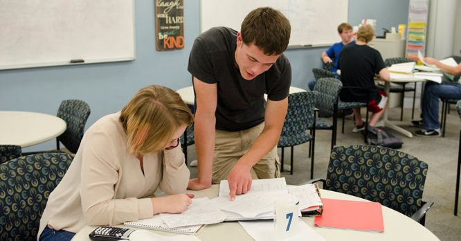 A peer tutor works with a student in RVC's Tutoring Center.