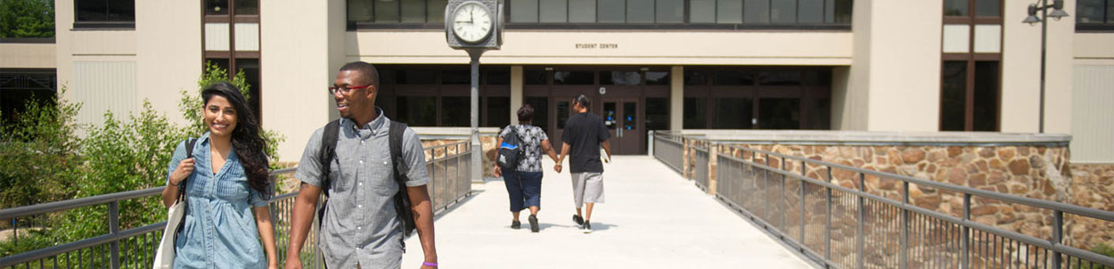 Students walk across the bridge from our Student Center.