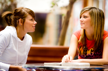 Two students having a conversation.