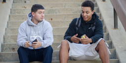 Two students on phones on the RVC campus.