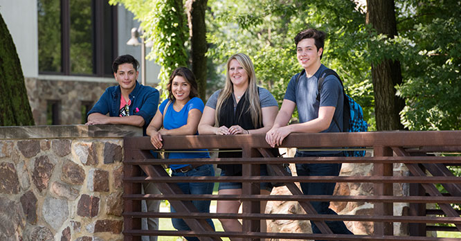 Students hanging out on the bridge between the ERC and Student Center