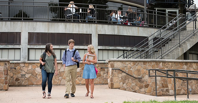 Students walking on main campus outside of the Student Center Atrium